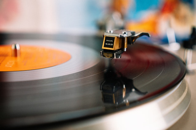 A vinyl record on a turntable, spinning
