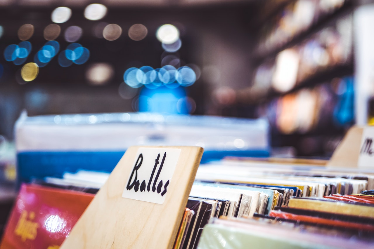 vinyl records in a record shop, with The Beatles albums front and center